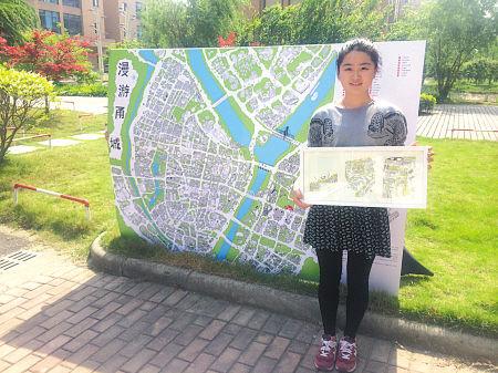 手绘宁波地图和它的创作者之一戴艳藤。(王伊婧 摄)