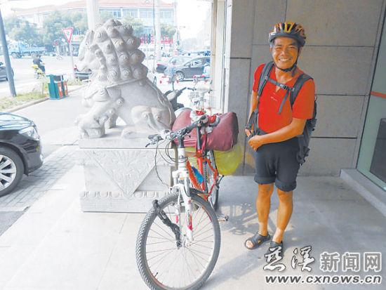 陈朝生即将离开慈溪踏上旅途。 摄影 记者 陈运运